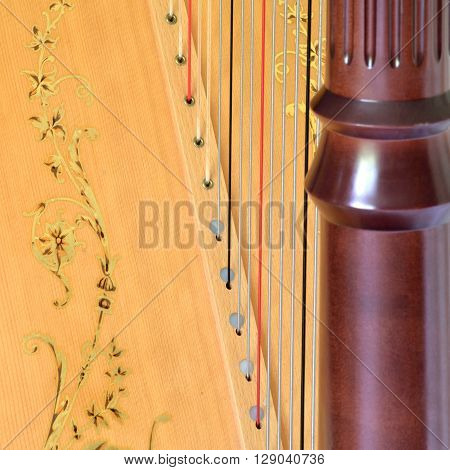 Closeup Of Pedal Harp Column Strings And Soundboard