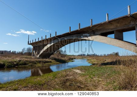 An old and unfinished bridge over a river