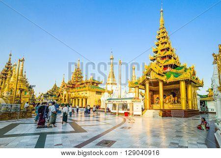 Yangon Myanmar - January 9 2012: Local people in the Swedagon Pagoda.