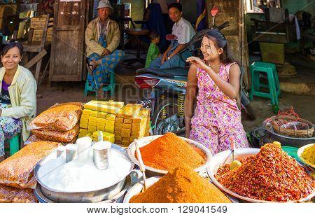 Yangon Myanmar - January 10 2012: Local vendors in the Hleku street market along the road from Yangon to Bago.