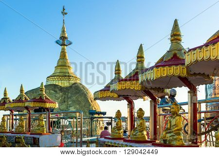 Myanmar Buddha shrine near the delicately balanced golden Stupa on the sacred Buddhist mountain of Kyaikhto