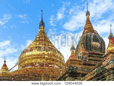 Myanmar, Bagan, the golden pagoda in the plain with thousand of 880-year old temple ruins.