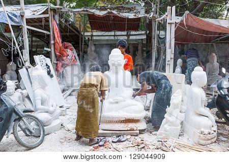 Mandalay Myanmar - January 13 2012: Marble workers prepearing Buddha statues.