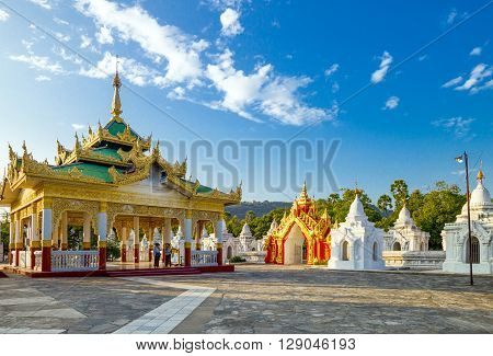 Mandalay Myanmar - January 13 2012: Tourists in the Shwenandaw Kyaung golden pagoda sanctuary.