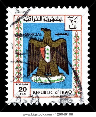 IRAQ - CIRCA 1975 : Cancelled postage stamp printed by Iraq, that shows Arms of Iraq.