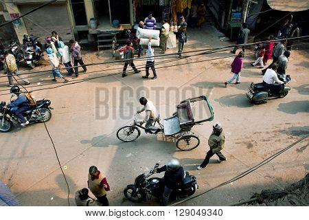 VARANASI, INDIA - JAN 4, 2013: View from the height on the traffic and the people on Indian streets on January 4, 2013 in ancient indian city. Varanasi urban agglomeration has a population 15 million