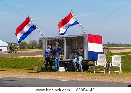 Lisse, Netherlands - 6 May 2016: Dutch flower stall selling flowers next to tulip field near village of Lisse the Netherlands
