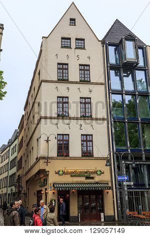Cologne, Germany - May 16: Each level of this house was built in different years as indicated on its facade May 16, 2013 in Cologne, Germany.