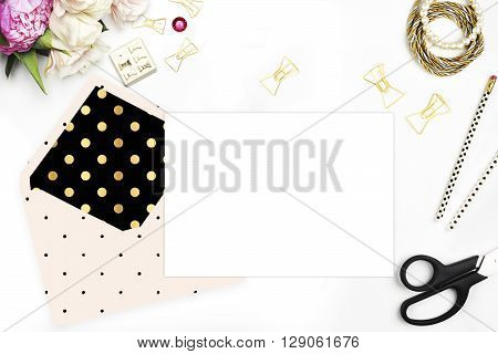 Template Invitation card, Mock up for your photo or text Place your work. Table view, Peonies and gold stationery. Flat lay