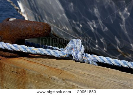 Focus on nautical rope tied to cleat in Newport Marina Rhode Island USA.