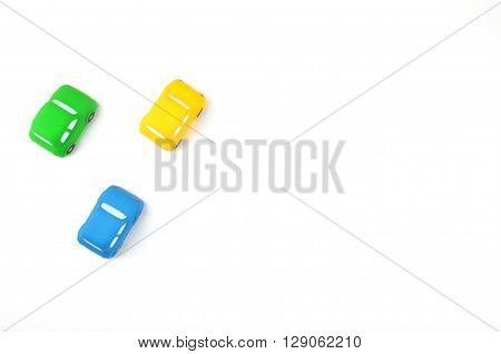 Colorful cars | Yellow, Blue, Green | White desktop | Toys style |