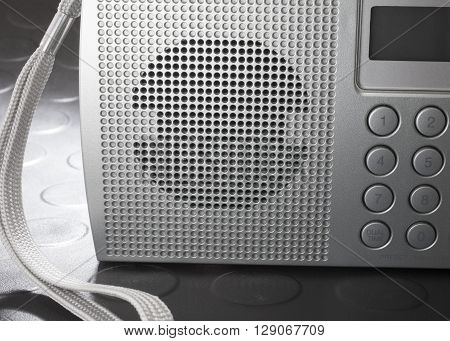 Speaker on front of a portable shortwave radio that runs on batteries