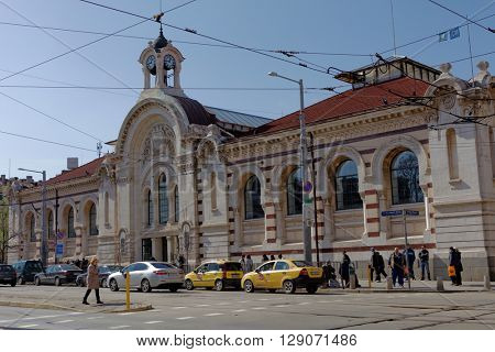 SOFIA, BULGARIA - MARCH 5, 2016: People in front of the Central Sofia Market Hall. The market hall was opened in 1911 and is today an important trade center in the city