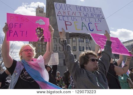 Asheville, North Carolina, USA - April 2, 2016: People hold signs protesting North Carolina's HB2 law that restricts the rights of those who are transgender