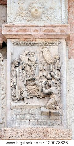 BOLOGNA, ITALY - JUNE 04: Jesus raised Lazarus by Casario, left door of San Petronio Basilica in Bologna, Italy, on June 04, 2015