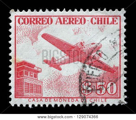 ZAGREB, CROATIA - SEPTEMBER 04: a stamp printed in the Chile shows Control Tower and Plane, circa 1956, on September 04, 2014, Zagreb, Croatia