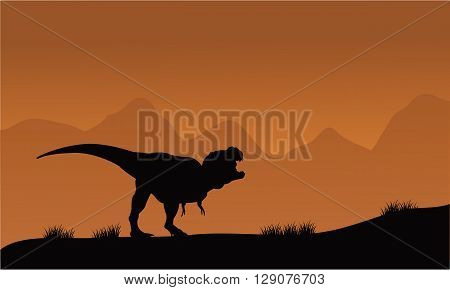 Silhouette of T-Rex in the fields with brown backgrounds