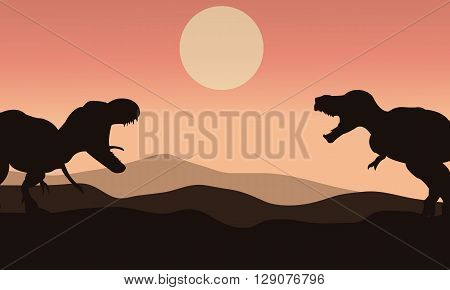 Silhouette of tyrannosaurus with sun at the morning