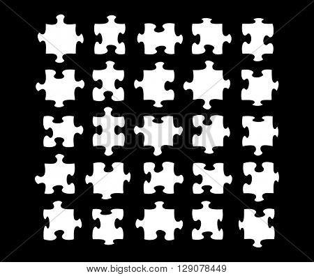 Twenty five blank jigsaw pieces on black background