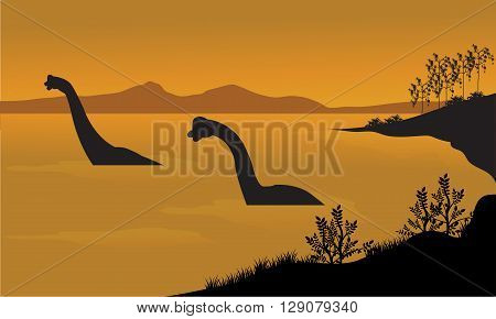 Silhouette of brachiosaurus in the water at the afternoon