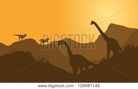 silhouette of brachiosaurus in hills with brown backgrounds