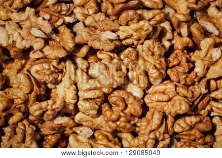 shelled walnuts background, closeup view