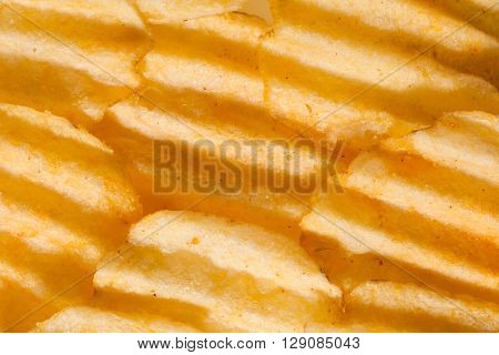 rippled potato chips background, closeup view
