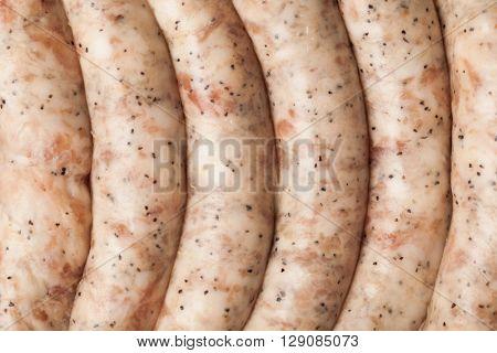 raw meat sausages, closeup view