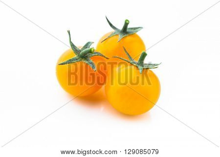 yellow cherry tomatoes isolated on white