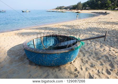 Round fishing boat made from bamboo and wood on the beach sand of Quy Nhon, central Vietnam.