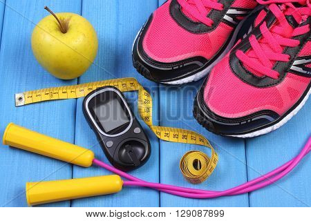 Glucose meter sport shoes apple and accessories for fitness or sport diabetes healthy and active lifestyles