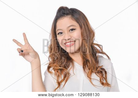 happy smiling young girl show victory sign