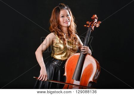 Young violin player isolated on black