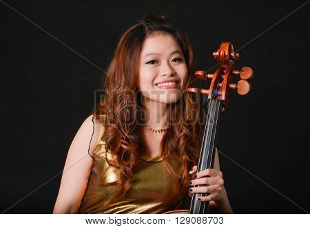 Beautiful young girl with violin, isolated on black