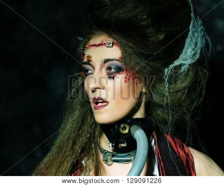 Young woman with creative make up. Close up.Halloween theme. Zombie theme.
