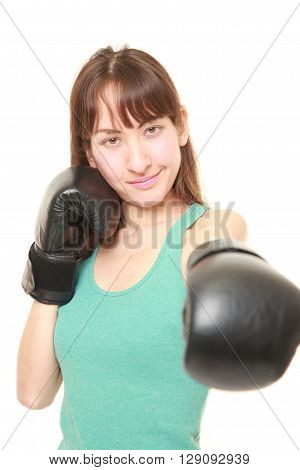 portrait of female boxer throwing a left jab on white background
