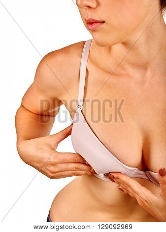 Nursing mother examines her nude breasts. Healthy female breasts.