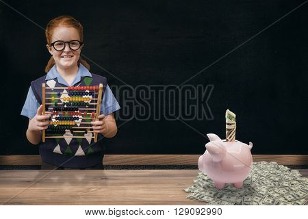Pupil with abacus against blackboard on wall