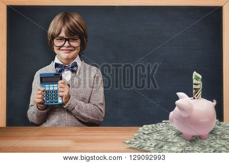 Pupil with calculator against dollar in piggy bank