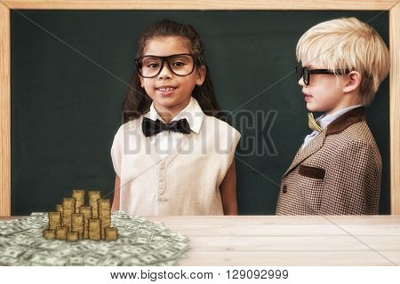 Cute pupils dressed up as teachers against gold coins
