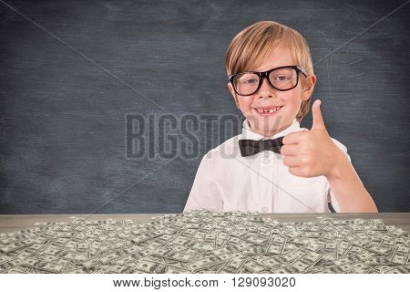 Cute pupil looking at camera against blue chalkboard