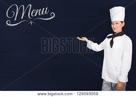 Confident female cook in the kitchen against navy blue