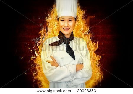 Portrait of smiling female cook in kitchen against red background with vignette