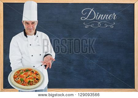 Chef displaying delicious pizza against dinner message on a white background