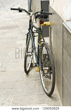 City bicycle close up parked on the street.