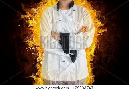 Portrait of confident female chef against shades of brown