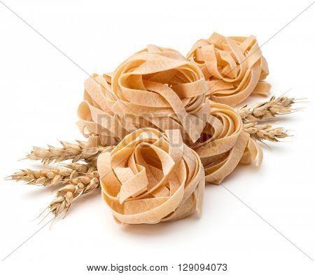 Italian pasta fettuccine nest and wheat ears still life isolated on white background