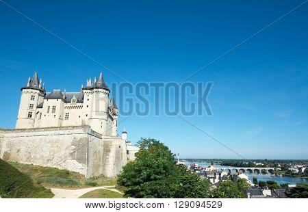 Saumur castle and Loire River, Loire Valley, France.