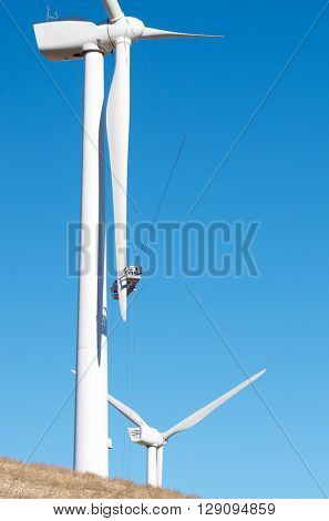 repair work on the blades of a windmill for electric power production, Pozuelo de Aragon, Zaragoza, Aragon, Spain