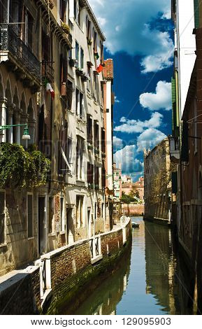 Historic houses in Venice on a background of blue sky.